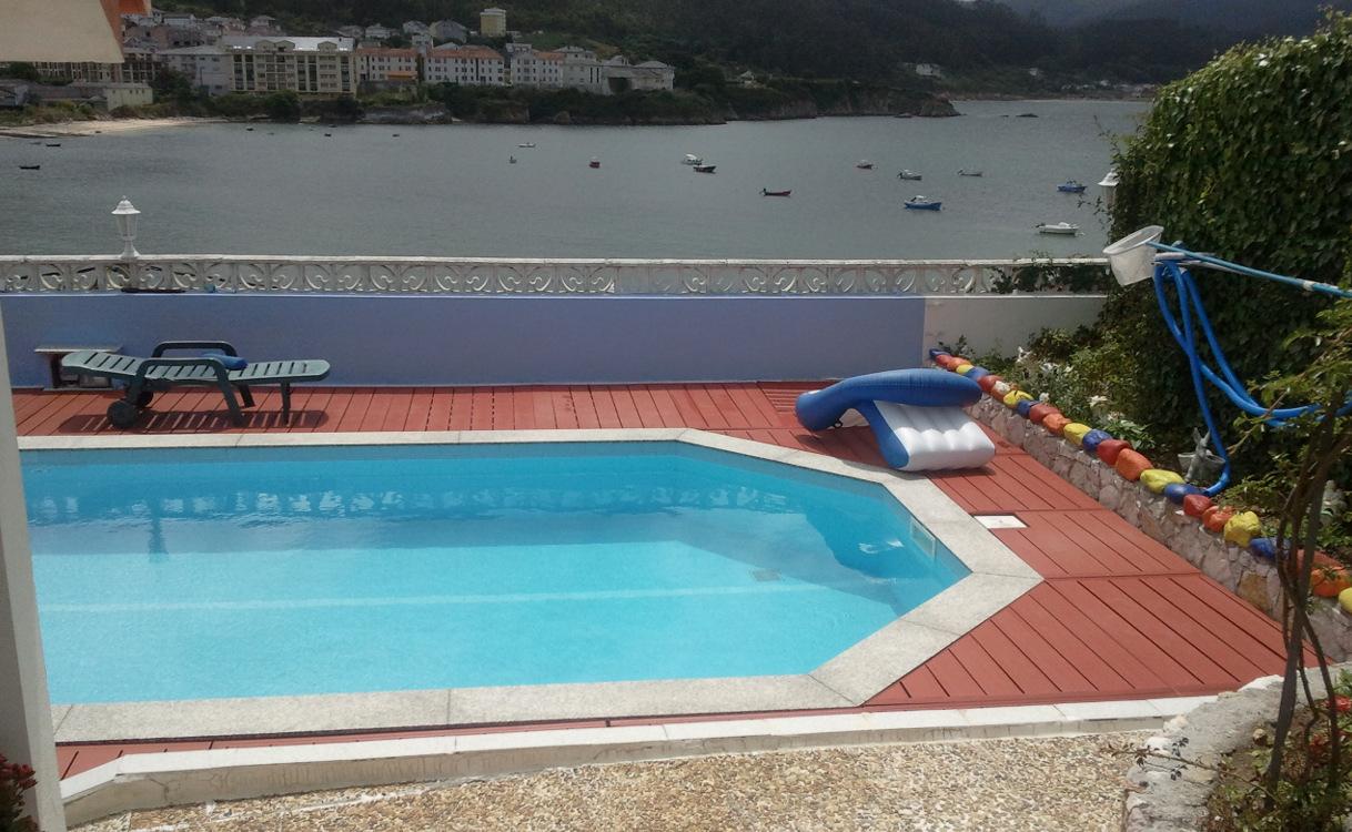 piscina exterior con suelo sinttico